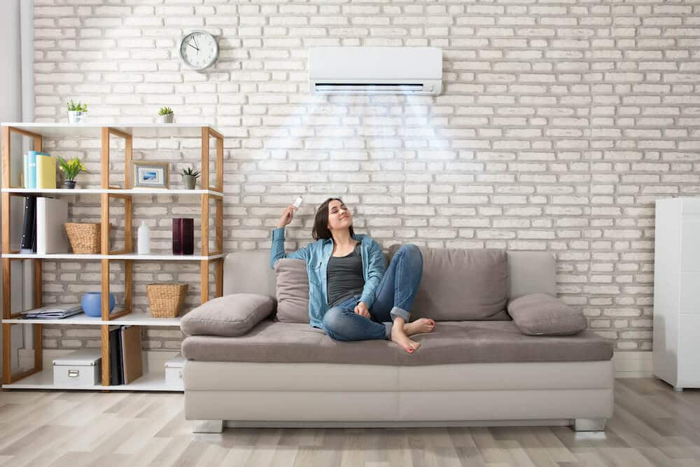 Woman Relaxing Under The Air Conditioner