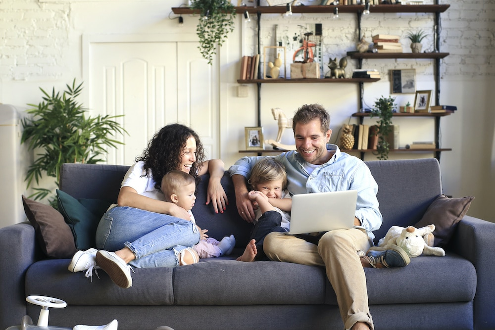 Family Sitting on Couch in Clean Air After an Air Duct Cleaning in Vienna, VA